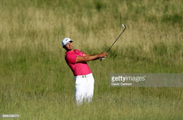 Jason Day of Australia plays his second shot on the par 4, 15th hole during the first round of the 117th US Open Championship at Erin Hills on June...