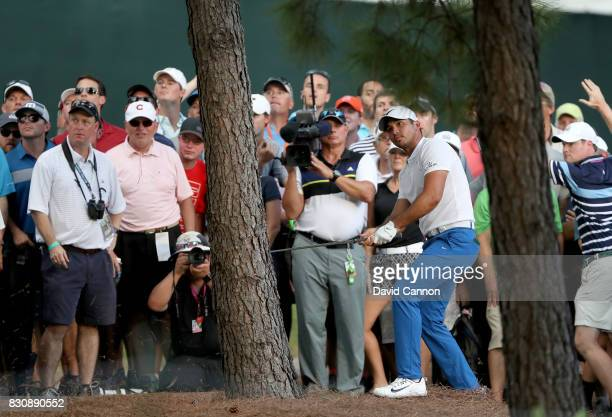 Jason Day of Australia plays his second shot on the par 4 18th hole during the third round of the 2017 PGA Championship at Quail Hollow on August 12...