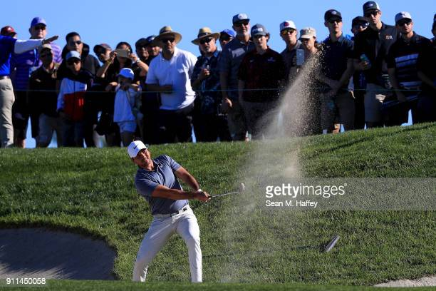 Jason Day of Australia plays his second shot on the second hole fairway bunker during the final round of the Farmers Insurance Open at Torrey Pines...