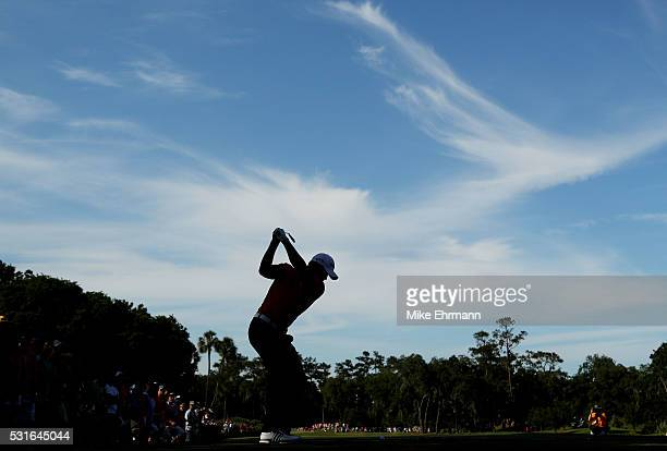 Jason Day of Australia plays his shot from the 12th tee during the final round of THE PLAYERS Championship at the Stadium course at TPC Sawgrass on...