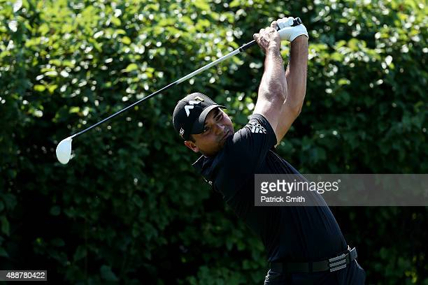 Jason Day of Australia plays his shot from the 13th tee during the First Round of the BMW Championship at Conway Farms Golf Club on September 17 2015...