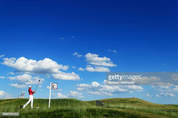 Jason Day of Australia plays his shot from the 14th tee during the first round of the 2017 US Open at Erin Hills on June 15 2017 in Hartford Wisconsin