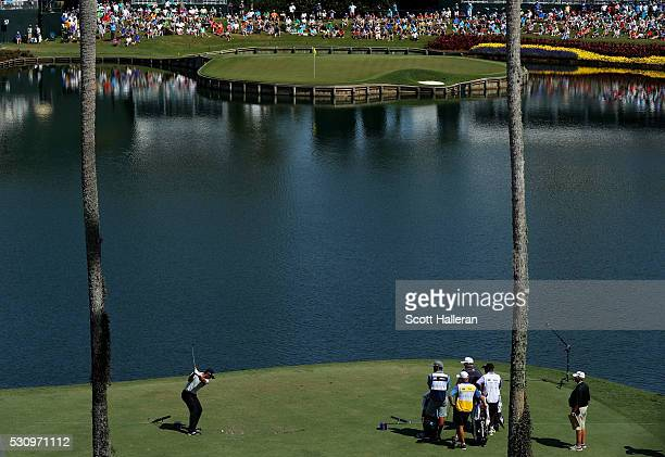 Jason Day of Australia plays his shot from the 17th tee during the first round of THE PLAYERS Championship at the Stadium course at TPC Sawgrass on...