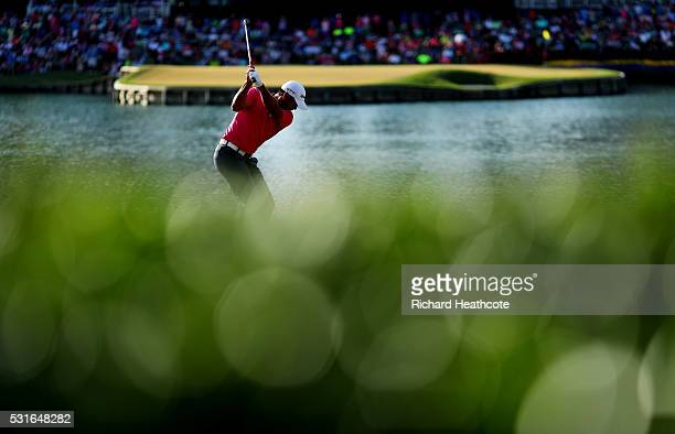 Jason Day of Australia plays his shot from the 17th tee during the final round of THE PLAYERS Championship at the Stadium course at TPC Sawgrass on...