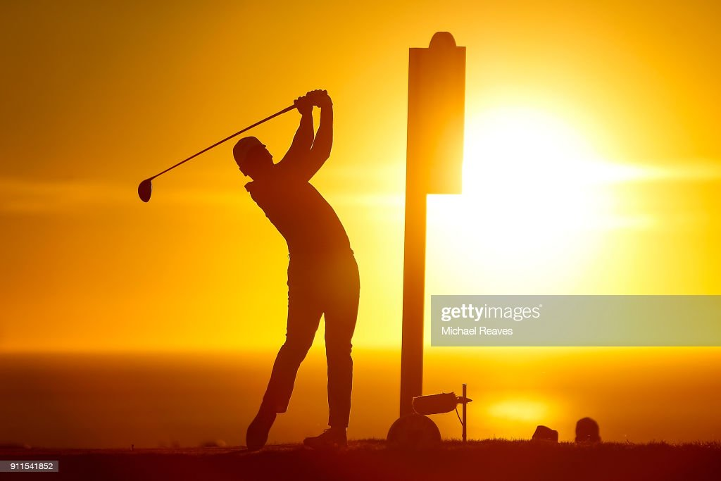 Jason Day of Australia plays his shot from the 17th tee in the fourth playoff hole during the final round of the Farmers Insurance Open at Torrey Pines South on January 28, 2018 in San Diego, California.