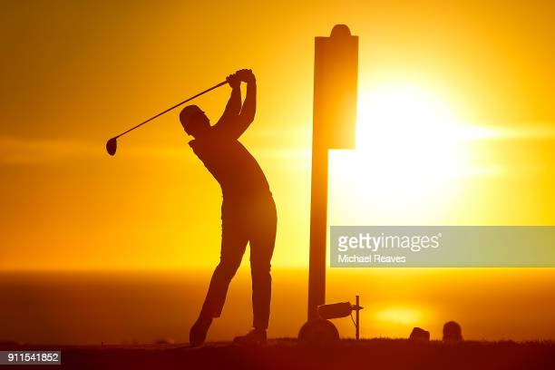 Jason Day of Australia plays his shot from the 17th tee in the fourth playoff hole during the final round of the Farmers Insurance Open at Torrey...
