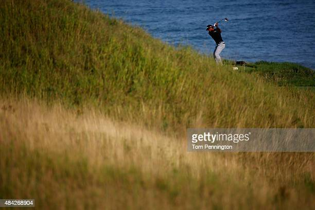 Jason Day of Australia plays his shot from the 18th tee during the final round of the 2015 PGA Championship at Whistling Straits on August 16 2015 in...
