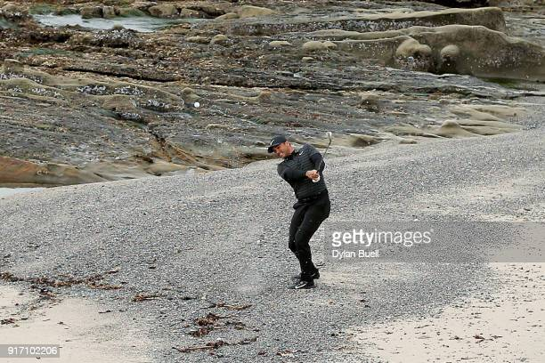 Jason Day of Australia plays his shot from the beach near the 18th hole during the Final Round of the ATT Pebble Beach ProAm at Pebble Beach Golf...