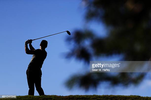 Jason Day of Australia plays his shot from the fifth tee during the final round of the SBS Tournament of Champions at the Plantation Course at...