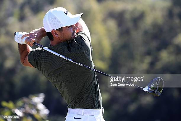 Jason Day of Australia plays his shot from the first tee during the proam prior to the SBS Tournament of Champions at the Plantation Course at...