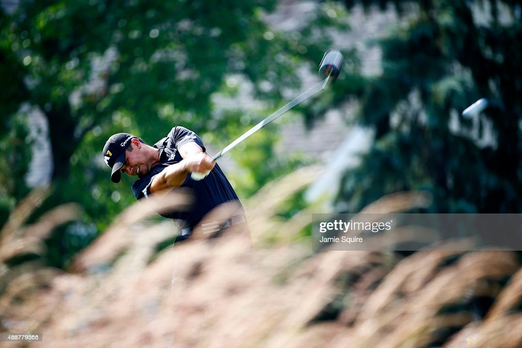 Jason Day of Australia plays his shot from the fourth tee during the First Round of the BMW Championship at Conway Farms Golf Club on September 17, 2015 in Lake Forest, Illinois.