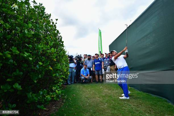 Jason Day of Australia plays his shot from the rough on the 18th hole during the third round of the 2017 PGA Championship at Quail Hollow Club on...