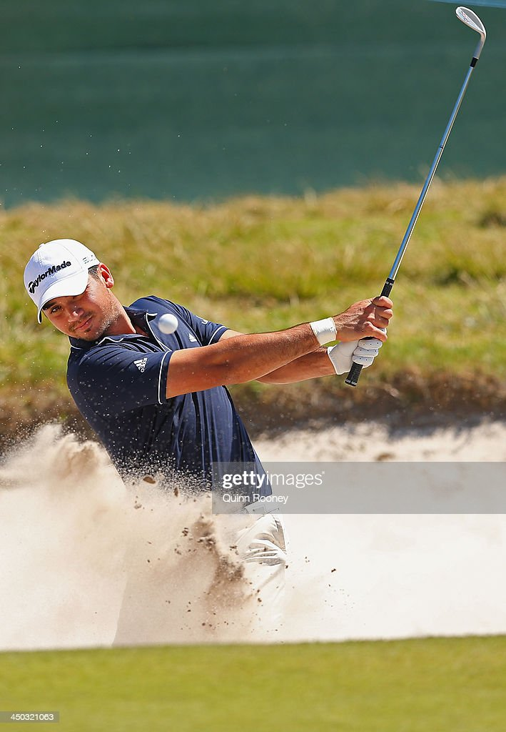Jason Day of Australia plays out of thew bunker during practice ahead of the World Cup Of Golf at Royal Melbourne Golf Course on November 18, 2013 in Melbourne, Australia.