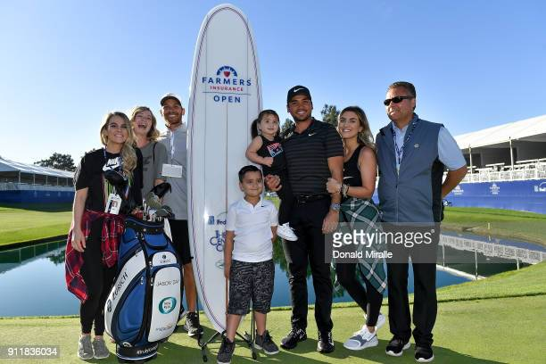 Jason Day of Australia poses with his wife Ellie Day his children Dash and Lucy and his caddie Rika Batibasaga after winning the Farmers Insurance...