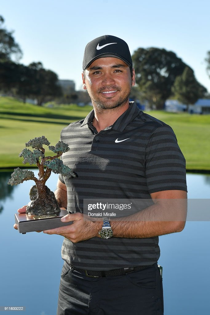 Jason Day of Australia poses with the trophy after the sixth playoff on the 18th hole to win the Farmers Insurance Open at Torrey Pines South on January 29, 2018 in San Diego, California.