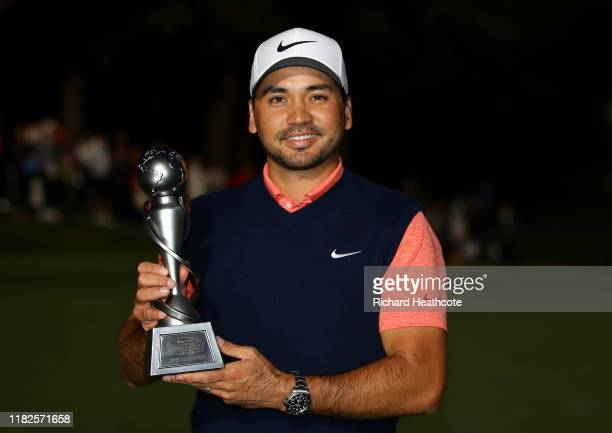 Jason Day of Australia poses with the trophy after winning The Challenge: Japan Skins at Accordia Golf Narashino Country Club on October 21, 2019 in...