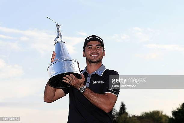 Jason Day of Australia poses with the trophy following the final round of the Arnold Palmer Invitational Presented by MasterCard at Bay Hill Club and...