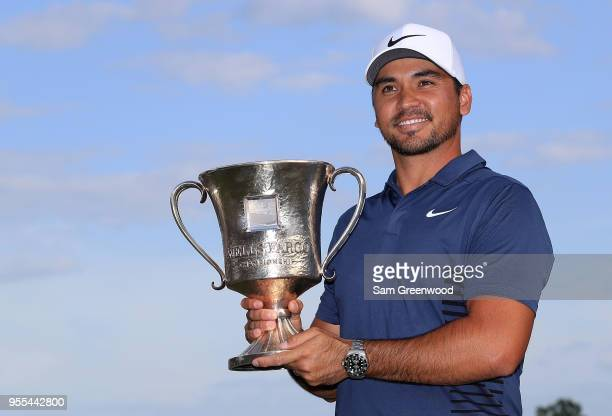 Jason Day of Australia poses with the trophy on the 18th green after winning the 2018 Wells Fargo Championship at Quail Hollow Club on May 6 2018 in...