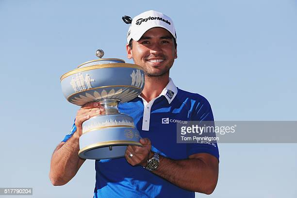 Jason Day of Australia poses with the Walter Hagen Cup after defeating Louis Oosthuizen of South Africa 54 in the championship match of the World...