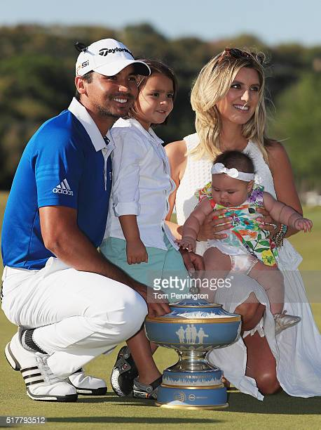 Jason Day of Australia poses with the Walter Hagen Cup alongside his son Dash wife Ellie and daughter Lucy after defeating Louis Oosthuizen of South...