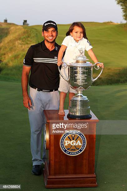 Jason Day of Australia poses with the Wanamaker Trophy and his son Dash after winning the 2015 PGA Championship with a score of 20under par at...