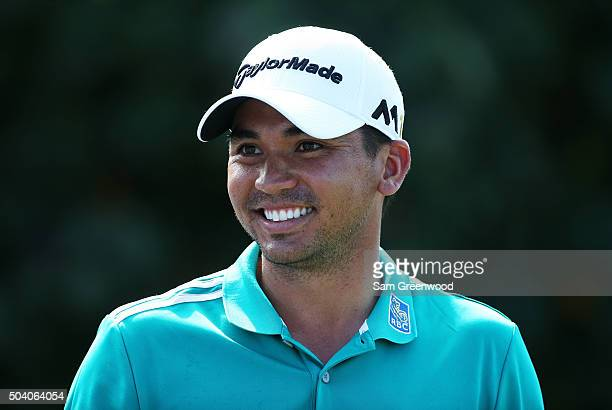 Jason Day of Australia prepares to play from the first tee during round two of the Hyundai Tournament of Champions at the Plantation Course at...