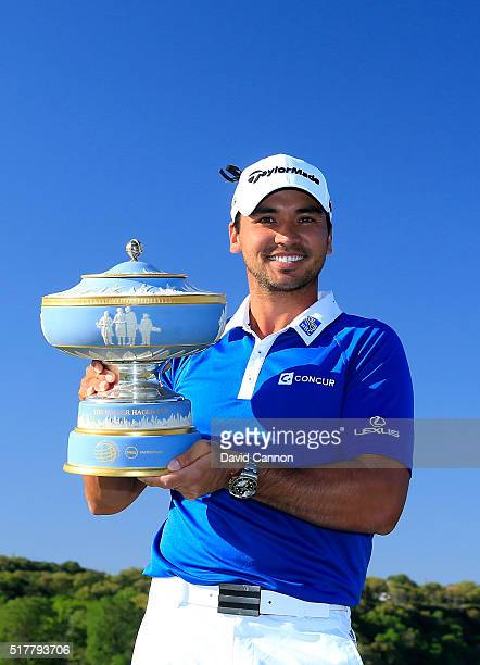 Jason Day of Australia proudly holds the Walter Hagen Cup after his 5&4 victory over Louis Oosthuizen in the championship match of the World Golf...