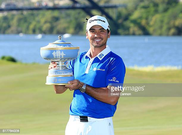 Jason Day of Australia proudly holds the Walter Hagen Cup after his 54 victory over Louis Oosthuizen in the championship match of the World Golf...