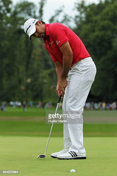 Jason Day of Australia putts for birdie on the 18th green during the third round of The Barclays at The Ridgewood Country Club on August 23 2014 in...