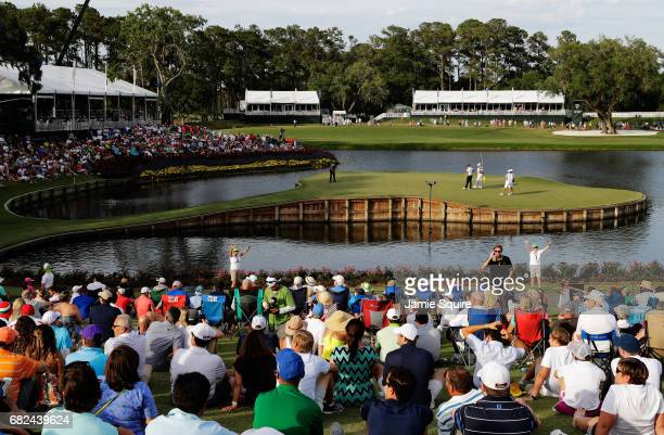 Jason Day of Australia putts on the 17th green during the second round of THE PLAYERS Championship at the Stadium course at TPC Sawgrass on May 12,...