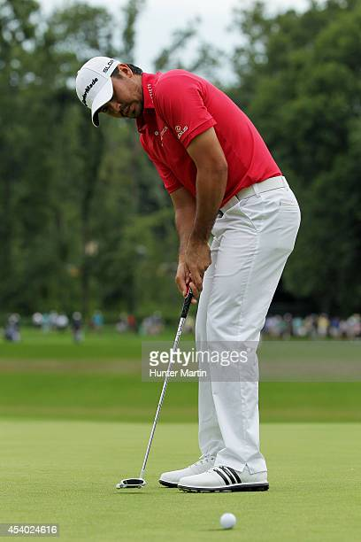 Jason Day of Australia putts on the 18th green during the third round of The Barclays at The Ridgewood Country Club on August 23 2014 in Paramus New...
