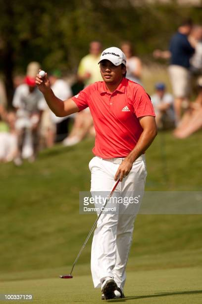 Jason Day of Australia raises his ball to acknowledge the crowd during the third round of the HP Byron Nelson Championship at TPC Four Seasons Resort...