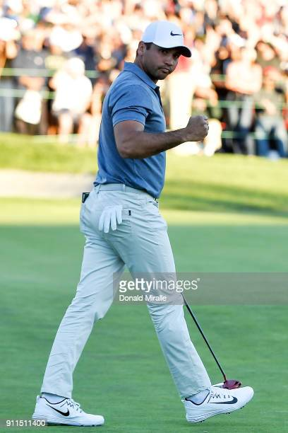 Jason Day of Australia reacts after a putt during the first playoff on the 18th hole during the final round of the Farmers Insurance Open at Torrey...