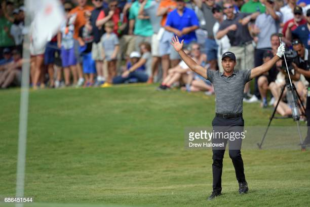 Jason Day of Australia reacts after chipping in for a birdie on the 15th hole during the Final Round of the AT&T Byron Nelson at the TPC Four Seasons...