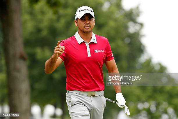 Jason Day of Australia reacts after chipping in for eagle on the second hole during the final round of the World Golf Championships Bridgestone...