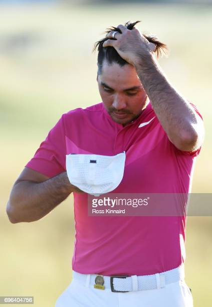 Jason Day of Australia reacts after finishing on the 18th green during the first round of the 2017 US Open at Erin Hills on June 15 2017 in Hartford...