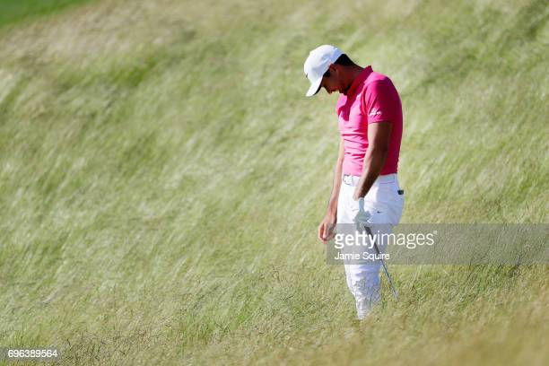 Jason Day of Australia reacts after his shot on the 11th hole during the first round of the 2017 US Open at Erin Hills on June 15 2017 in Hartford...