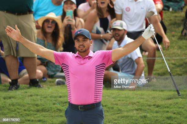 Jason Day of Australia reacts after holing out from a bunker on the ninth hole during the final round of THE PLAYERS Championship on the Stadium...