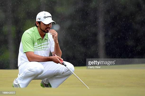Jason Day of Australia reacts after missing a birdie putt on the 18th green during the final round of the 2013 Masters Tournament at Augusta National...
