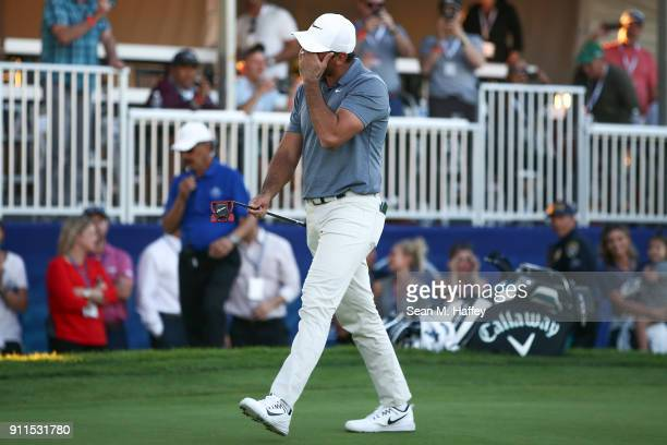 Jason Day of Australia reacts after missing a putt on the 16th hole in the third hole of the playoff during the final round of the Farmers Insurance...