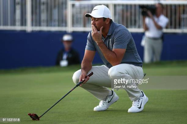 Jason Day of Australia reacts after missing a putt on the 17th green on the fourth playoff hole during the final round of the Farmers Insurance Open...