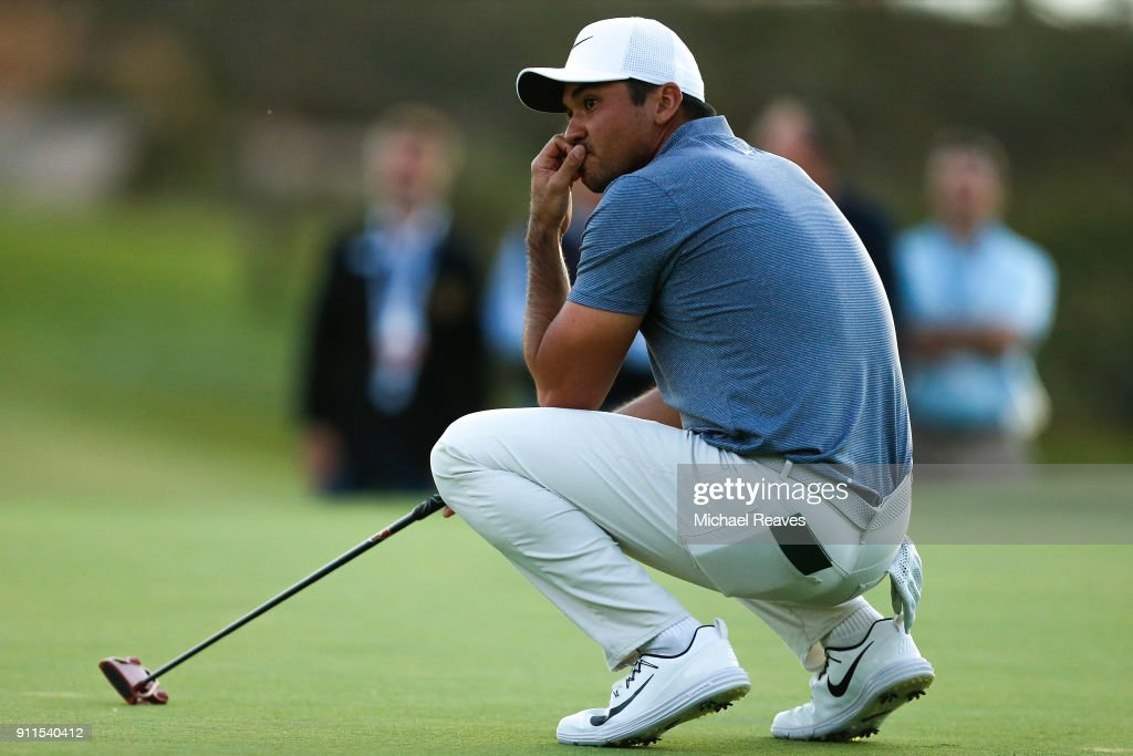 Jason Day of Australia reacts after missing a putt on the 17th green on the fourth playoff hole during the final round of the Farmers Insurance Open at Torrey Pines South on January 28, 2018 in San Diego, California.