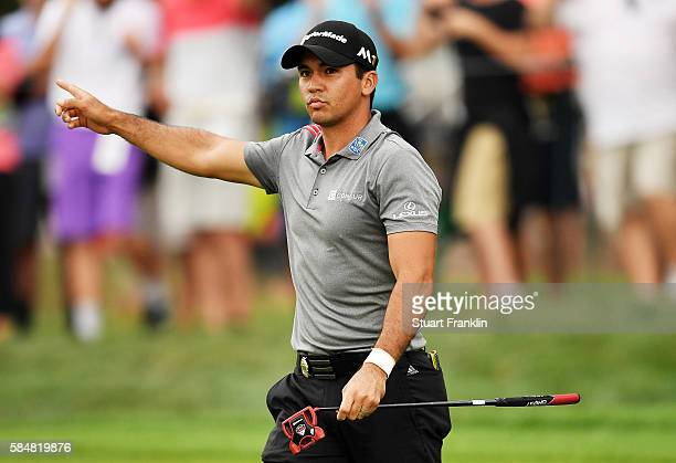 Jason Day of Australia reacts after putting for birdie on the sixth green during the continuation of the weather delayed third round of the 2016 PGA...