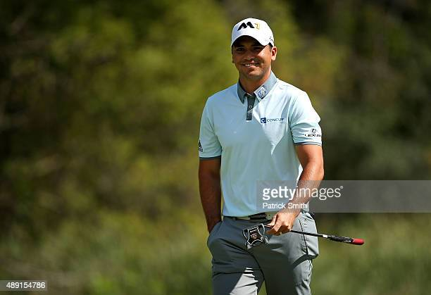 Jason Day of Australia reacts after putting on the sixth green during the Third Round of the BMW Championship at Conway Farms Golf Club on September...