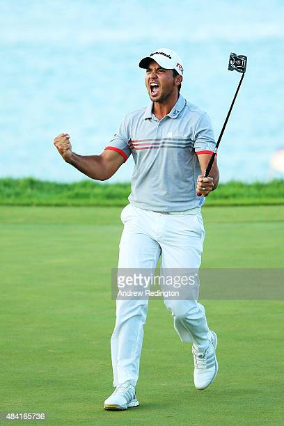 Jason Day of Australia reacts after sinking a putt on the 17th green during the third round of the 2015 PGA Championship at Whistling Straits at on...