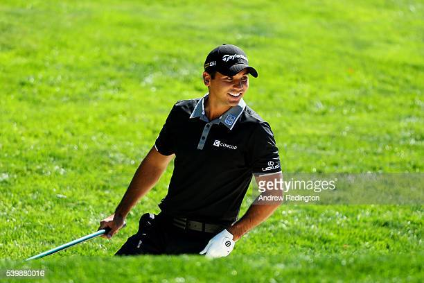 Jason Day of Australia reacts after taking his shot on the 16th hole during a practice round prior to the US Open at Oakmont Country Club on June 13...
