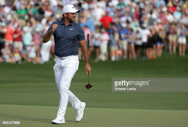 Jason Day of Australia reacts following his par putt on the 18th green during the final round to win the 2018 Wells Fargo Championship at Quail...