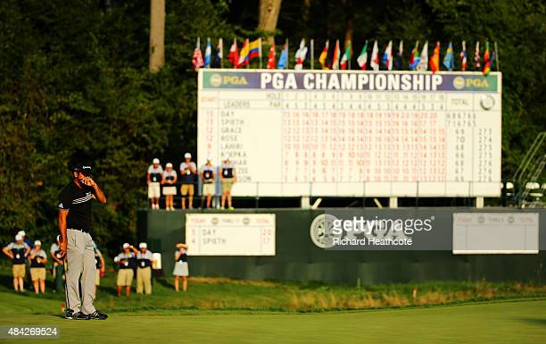 Jason Day of Australia reacts on the 18th green during the final round of the 2015 PGA Championship at Whistling Straits on August 16 2015 in...