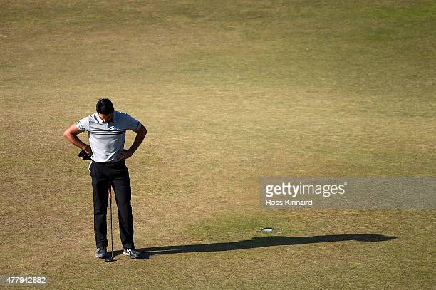 Jason Day of Australia reacts on the 18th green during the third round of the 115th US Open Championship at Chambers Bay on June 20 2015 in...