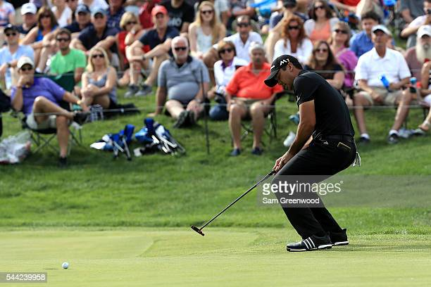 Jason Day of Australia reacts to a missed birdie putt on the 18th green during the third round of the World Golf Championships Bridgestone...